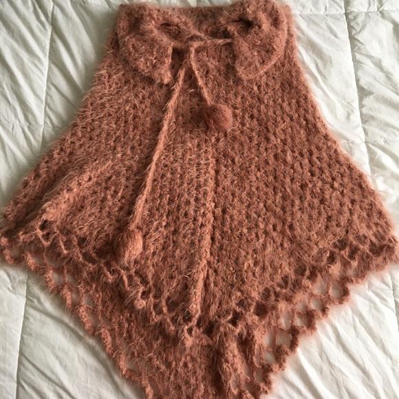 A blush color wool ponchos.